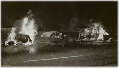 burning cop cars white night riot.JPG